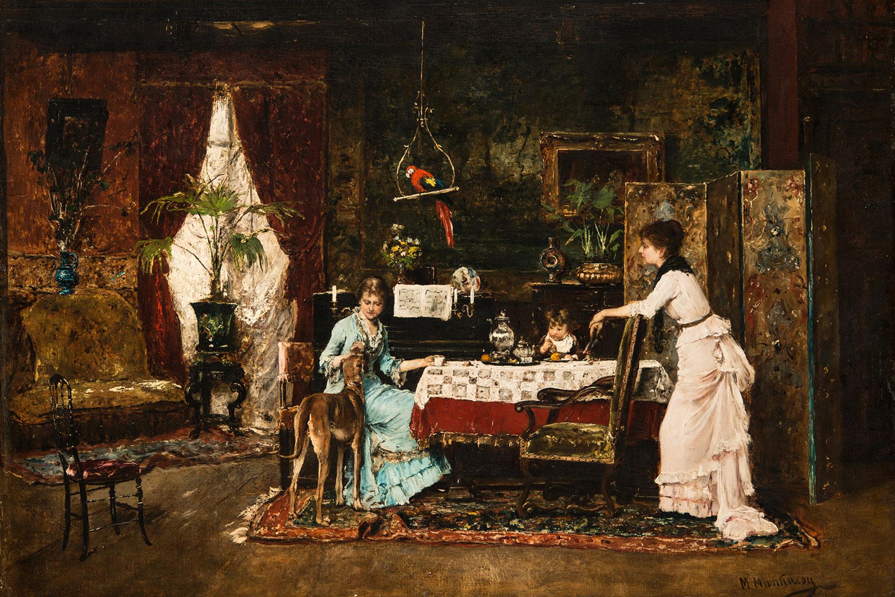 Zwei Frauen mit Kind am Esstisch. Über ihnen ein PApagei, neben ihnen ein Windhund